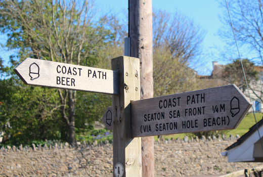 Great Reasons to Visit Seaton South West Coast Path Seaton to Beer finger post sign
