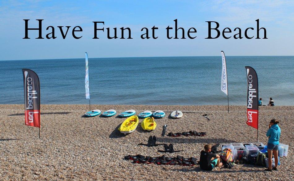 Paddle Boarding in Devon and Dorset Seaton beach scene