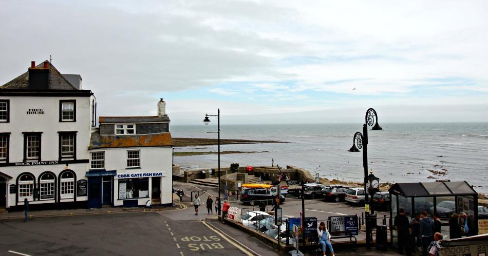 open top bus sightseeing tour devon and dorset Lyme Regis rockpoint