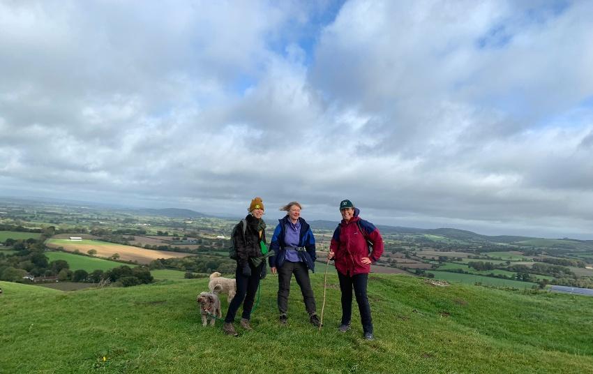 Top Best Walks in Dorset 3 walkers on a hill